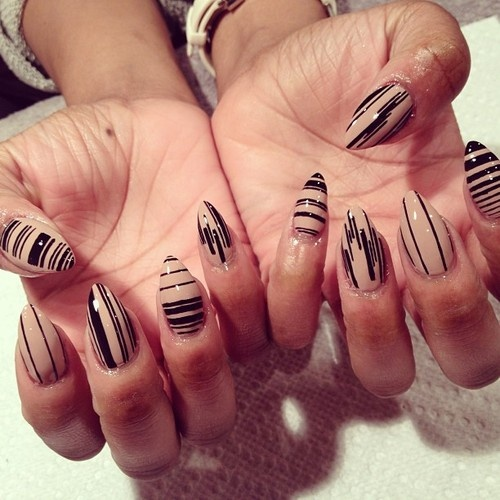 Stunning Black And Beige Nail Art With Lining Designs