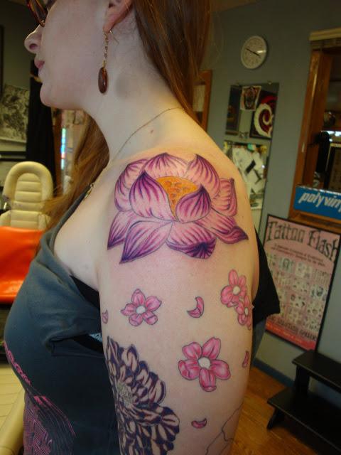 Superb Flower Tattoo On Arm For Girls