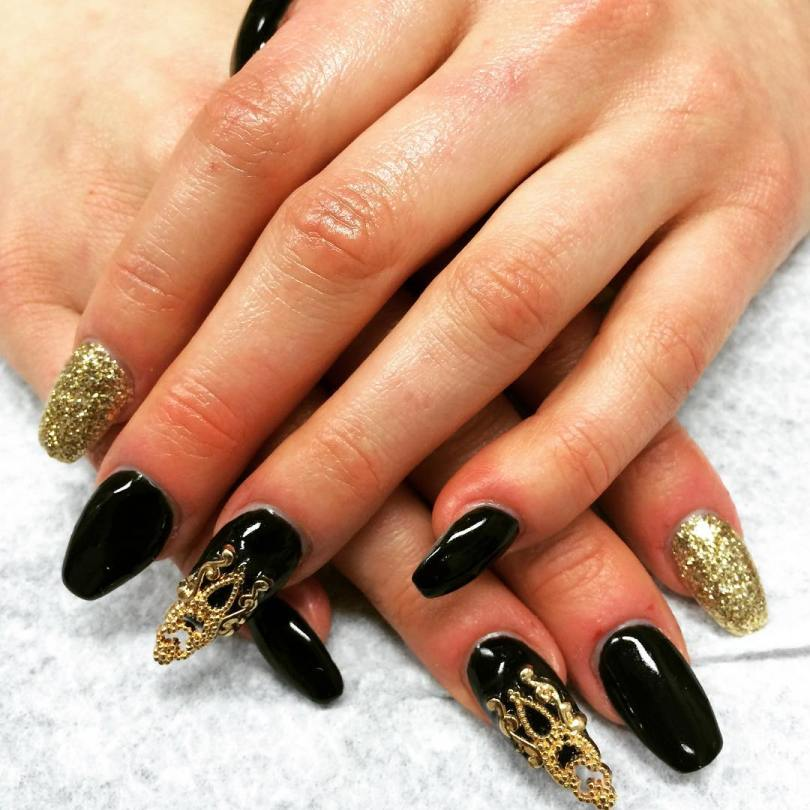 Superb Stiletto Nails With Golden Paint Design