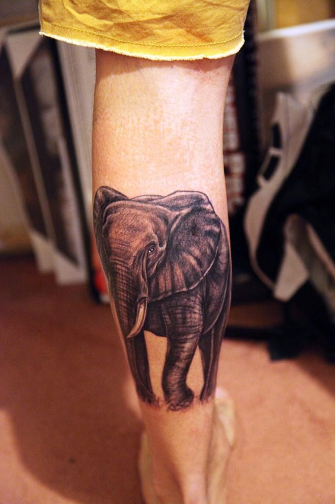 Terrific Elephant Tattoo On Back Leg For Girls