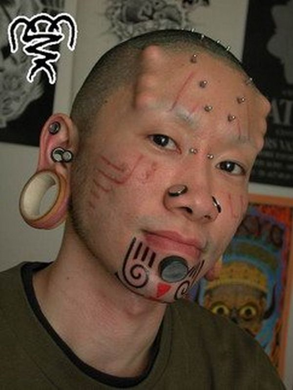 Traditional Extreme Body Modification Tattoo Design For Boys