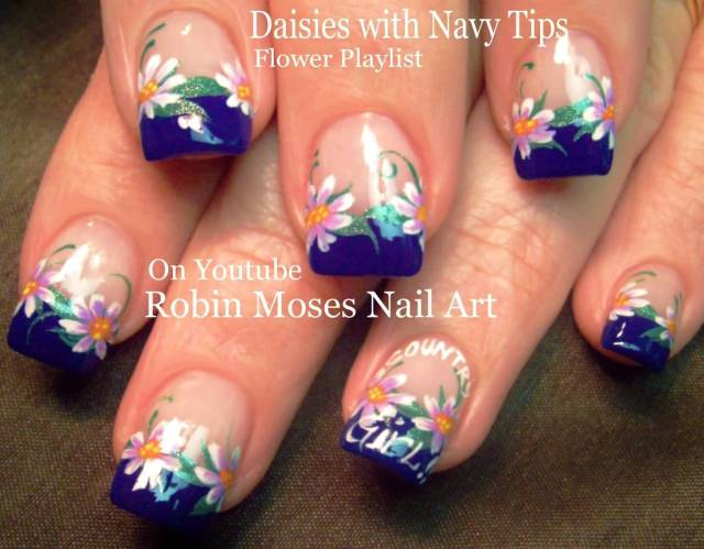Tremendous Blue Nail Art With Flower Design