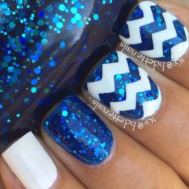 Tremendous Blue Nail Art With White Color Lining Design