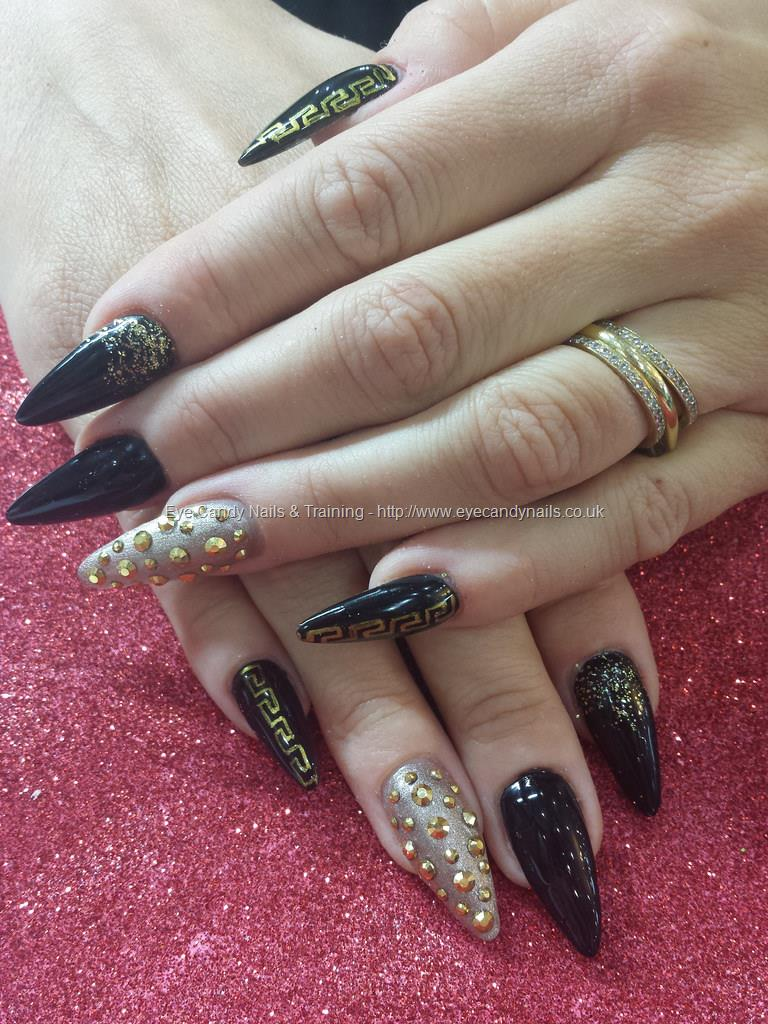 Tremendous Stiletto Nails With Black And Golden Design