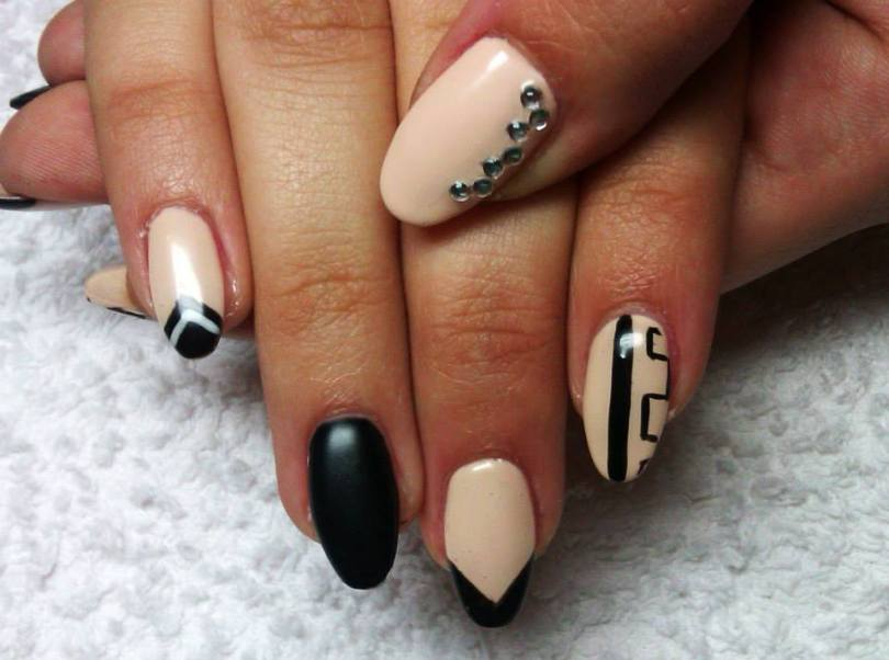Unique Black And Beige Nail Art With Crystal Designs