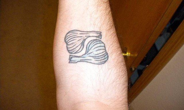 Weird Garlic Pair Tattoo On Arm For Boys