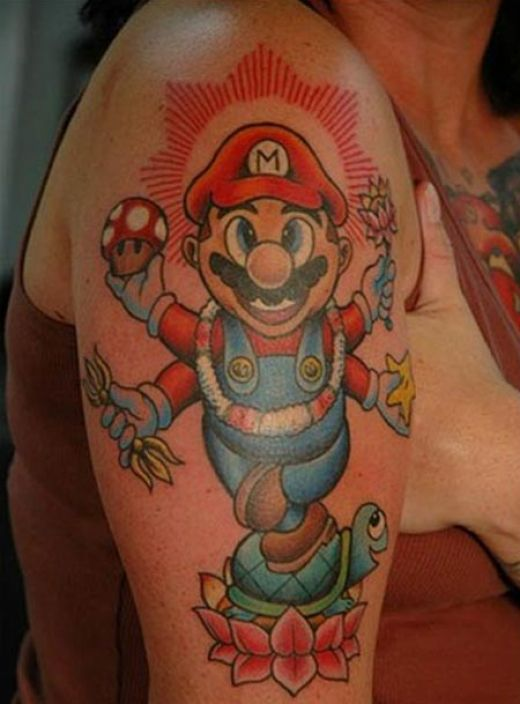 Weird Geek Mario Tattoo On Biceps For Girls