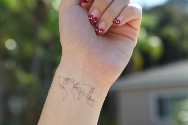 Awesome World Map Tattoo On Arm For Women