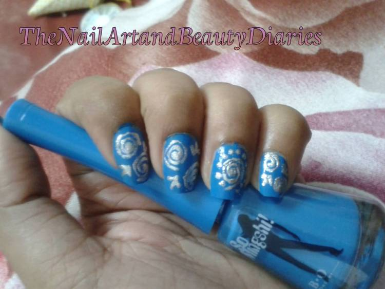 Eye Catching Blue Silver Nails