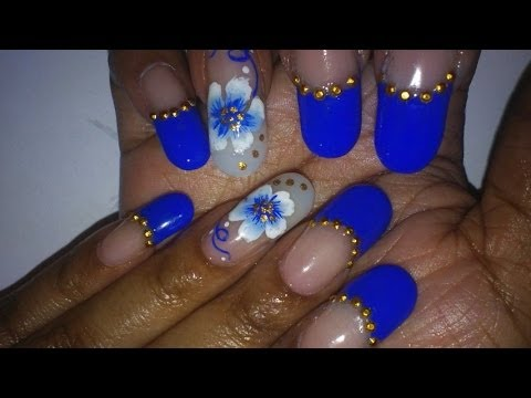Fantastic Blue Nails With Flower Design