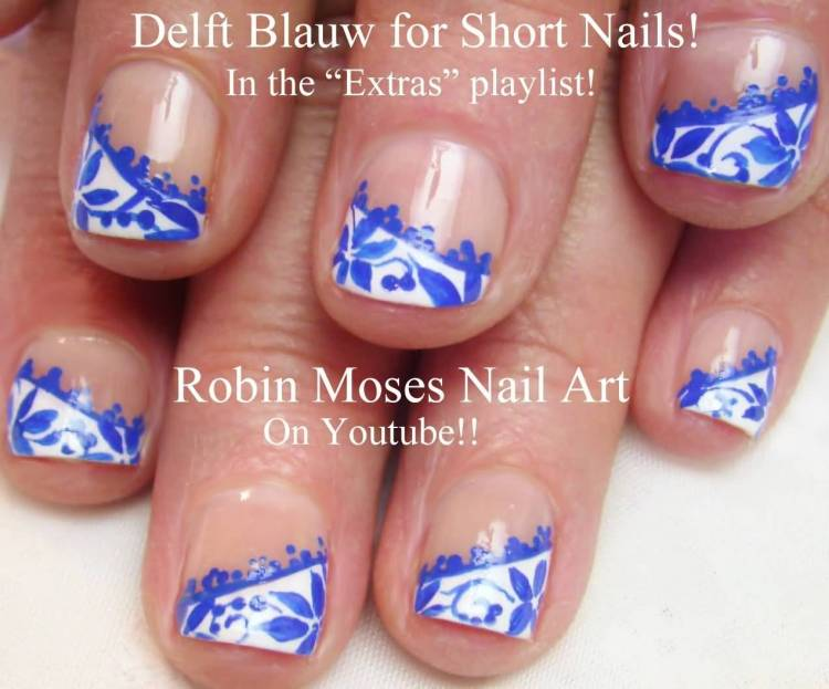 Stunning Blue Nails With Flower Design
