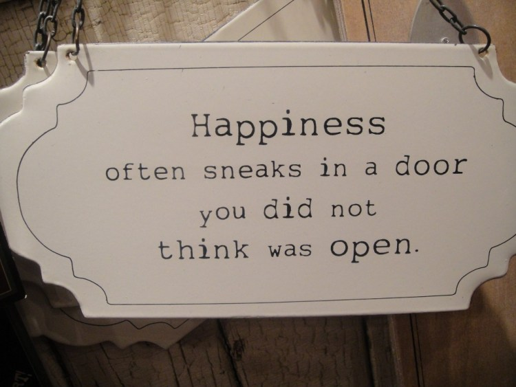 Motivational Love Quotes happiness often sneaks in a door