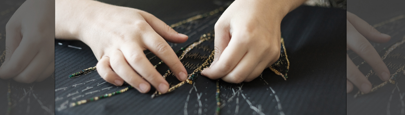 hands doing embroidery