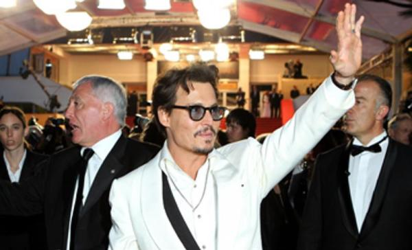 Johnny Depp's arm now reads
