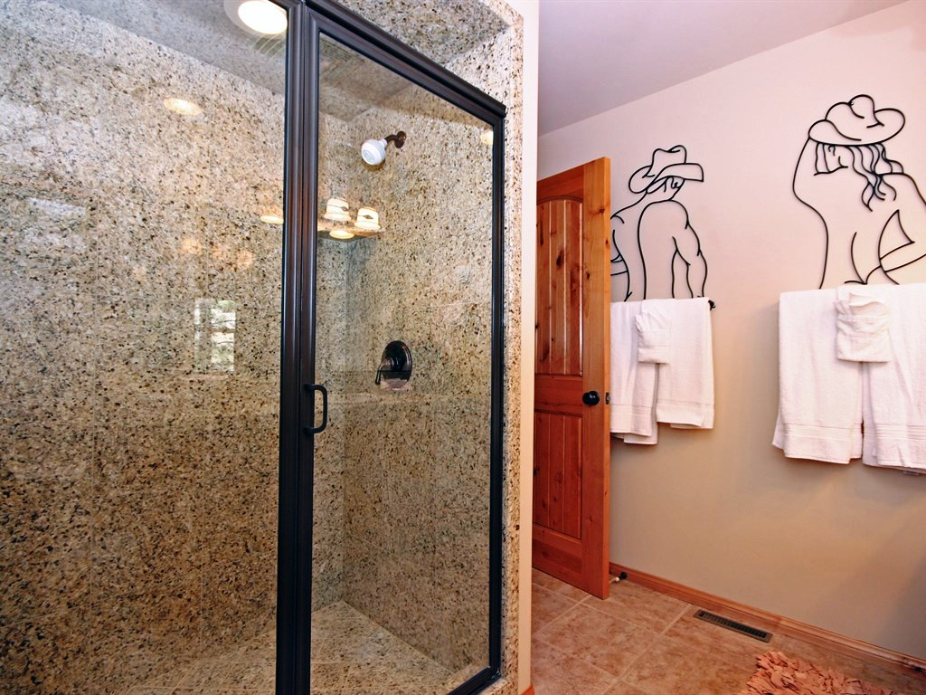 Large shower and humerus/rustic decor.