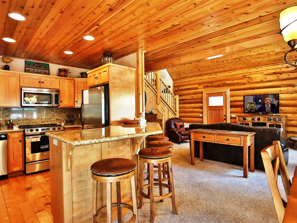 Beautiful kitchen, bar, comfy stools and cozy dining room with a fireplace make this a fun place to spend quality time alone or with those you love.