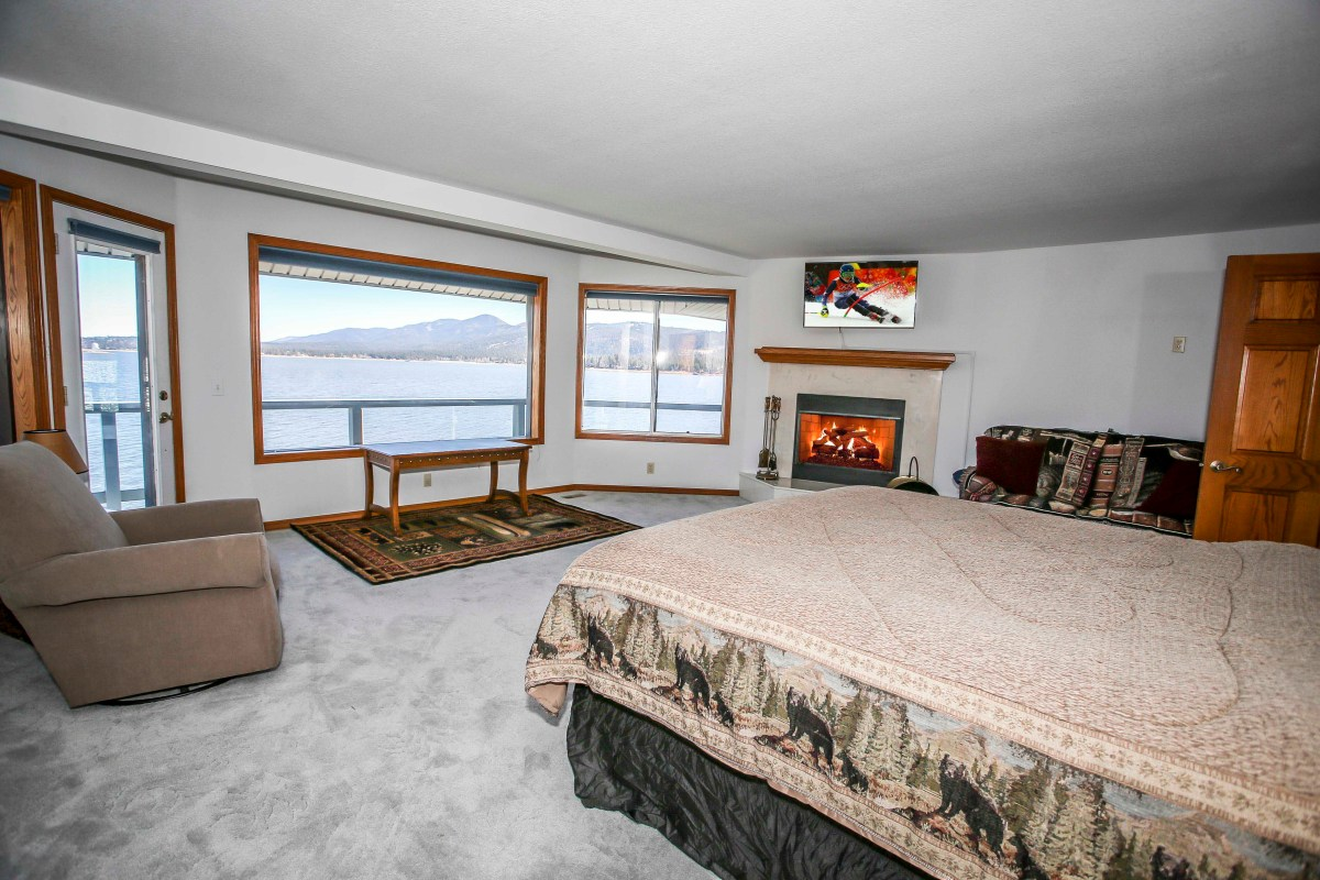 Master Bedroom with King bed, rustic decor and gorgeous views of Big Bear Lake.