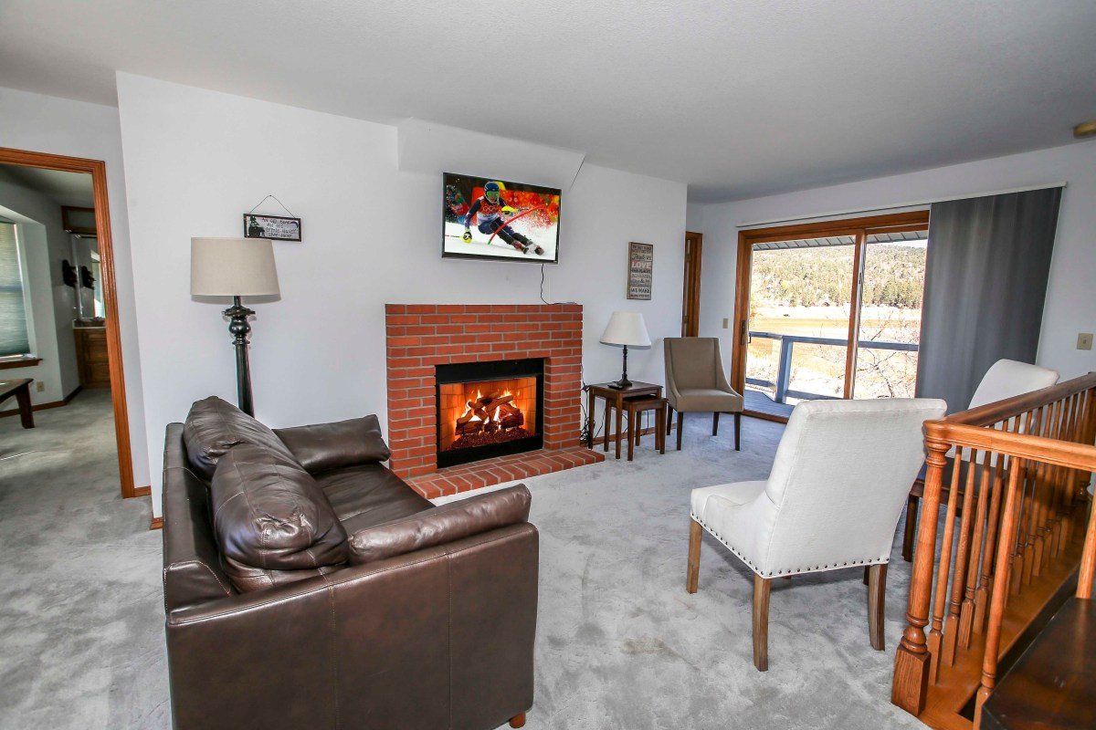 Lounge Area with Fireplace and Entertainment Center.