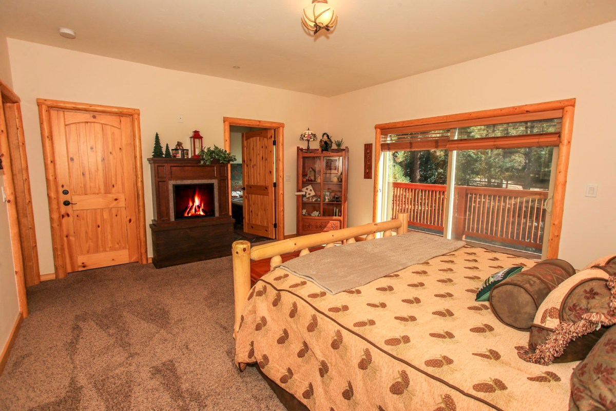 Bedroom with King Bed and Fireplace