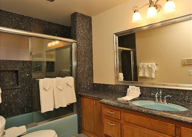 Beautiful bathroom with large shower/bath and modern feel.
