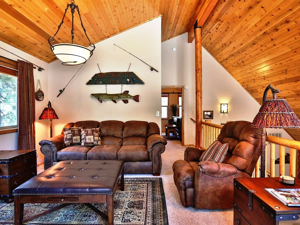 A great place to hangout, includes comfy furniture and a lovely rug.