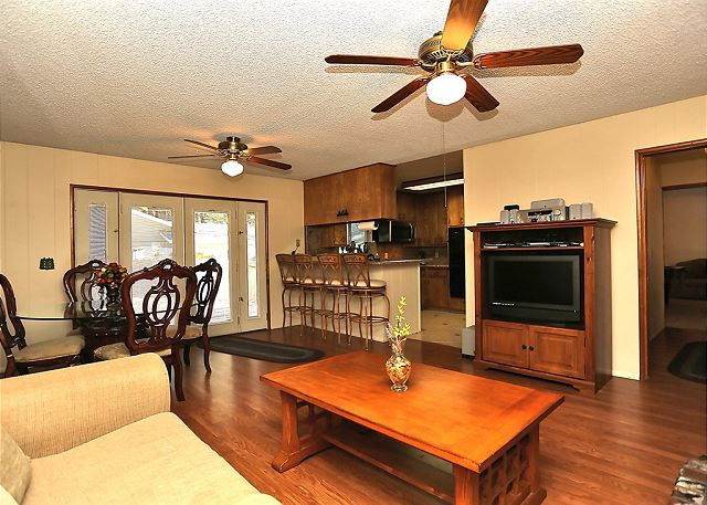 Spacious Living Room with Entertainment Center, Dining Area and Kitchen.