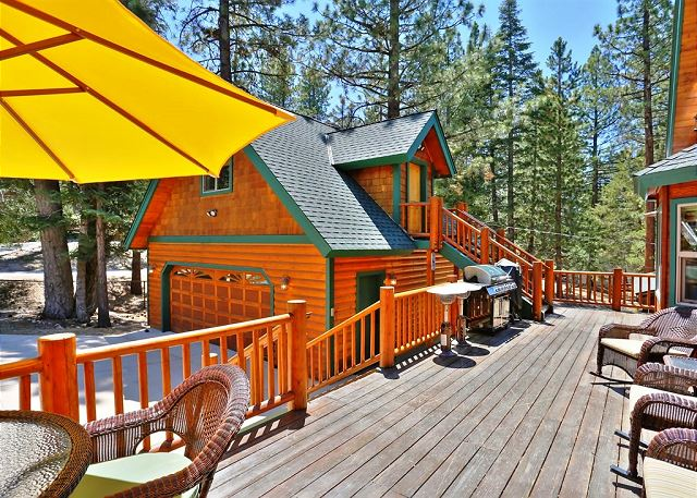 This property includes a beautiful wood patio with comfy furniture and great views of the surrounding forest with access to the guest house.
