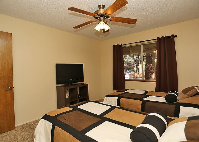 Includes two twin size beds, a large window with a great view of the surrounding forest, and a high definition T.V.