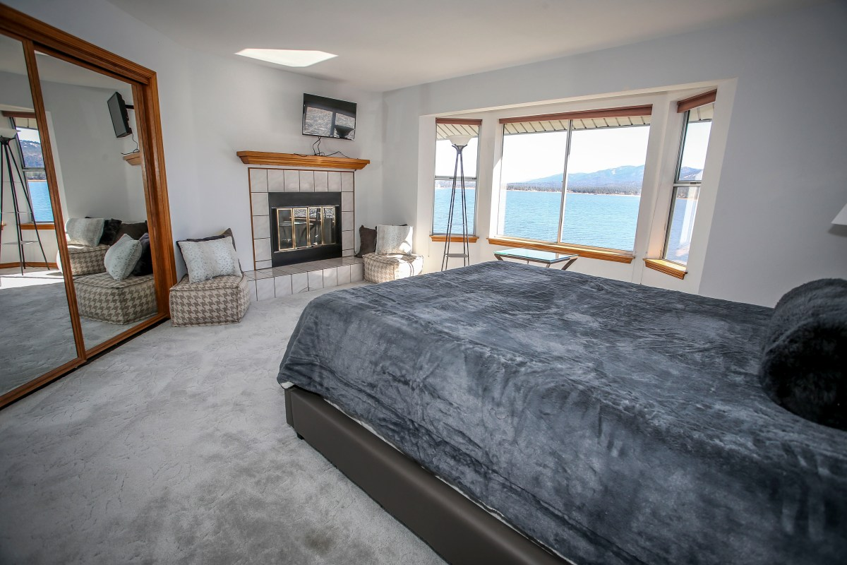 Bedroom #6 with Queen bed and Fireplace. The perfect place to cozy up on a cool Big Bear evening.