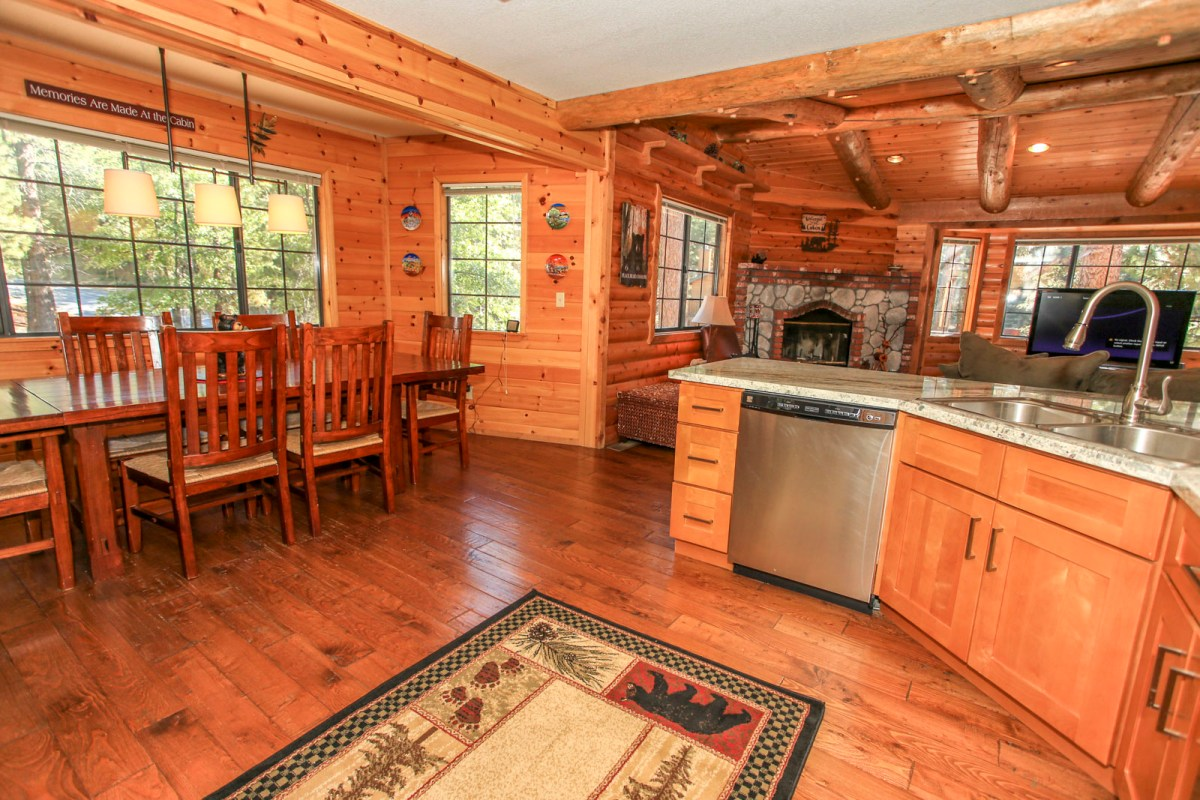 Imagine preparing food and dining in this spacious kitchen and dining area, over looking the beautiful San Bernardino National Forest.