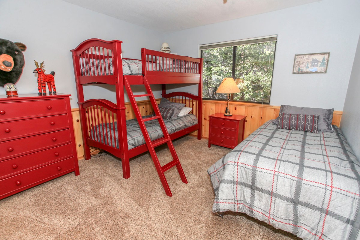 An ideal bedroom for families or groups needing a little extra sleeping space.