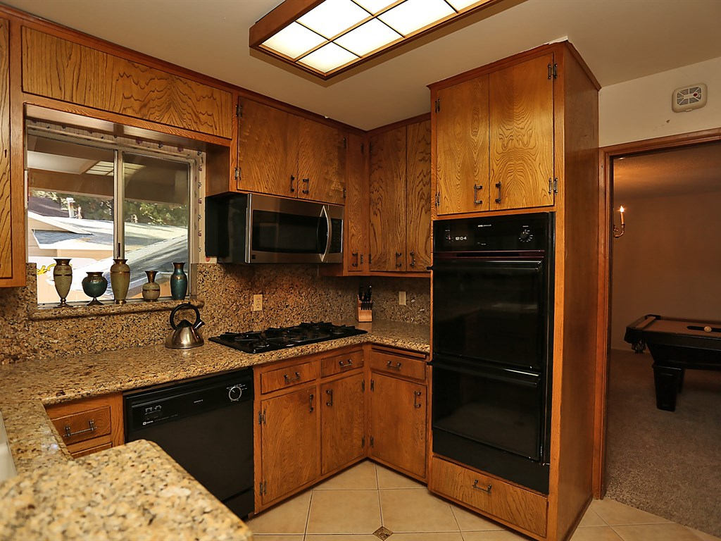 Beautiful cabin kitchen showing access to Game Room.