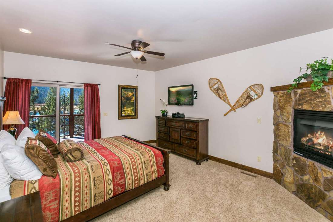 Master Bedroom has a King bed, fireplace and access to back deck