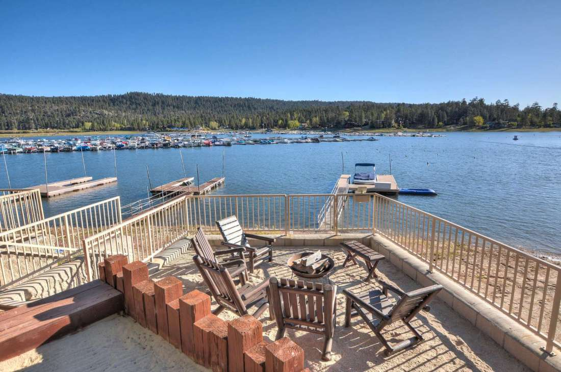 A second lower seating area on the water with newer dock in Deep Water  (fire pit not included)