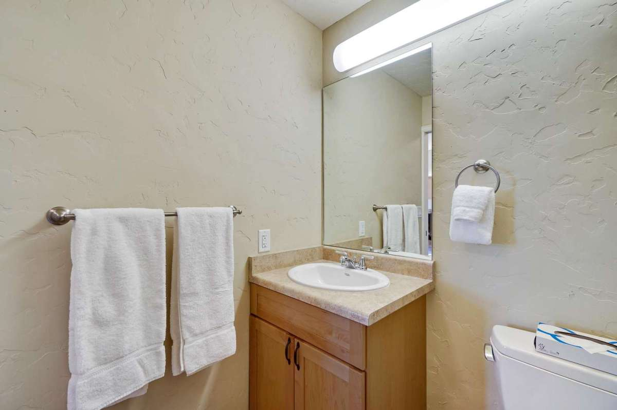 Half bath equipped with towels and amenities.