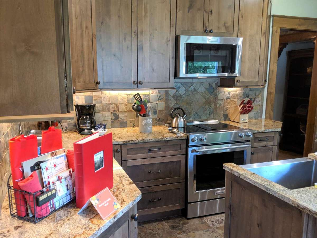 Beautiful Granite Counter tops Loaded with Cookware, Utensils and More