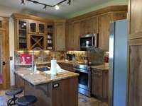 Kitchen is fully stocked with cookware, dinnerware, utensils and more thumb