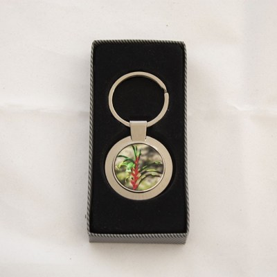 metal keyring with photo of a kangaroo paw