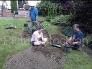 Trench in the back garden of Mr & Mrs Merrit's house. Lorraine Watkinson, Archaeologist (front right), Robin Daniels Archaeology Officer Tees Archaeology (centre) Lauren Walker, volunteer (rear)
