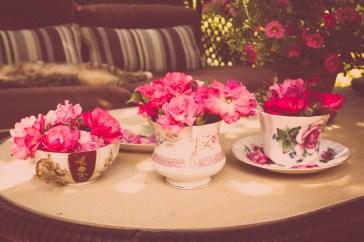 Pink Flowers in a tea cup vases! CUTE!