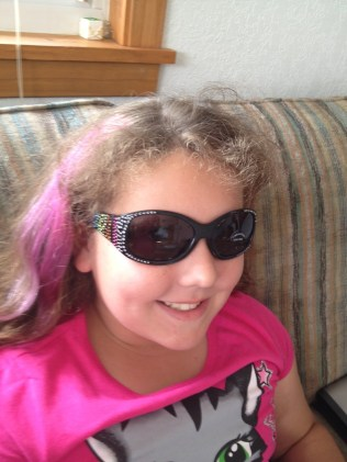 """Aurora's new """"bling"""" sunglasses! Only $6.00 at Untamed Accessories and Clothing, downtown Rapid City!"""