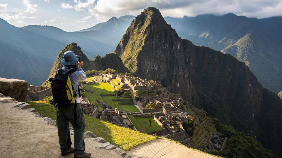 Inca trail packing list - Tourist photographing Machu Picchu.
