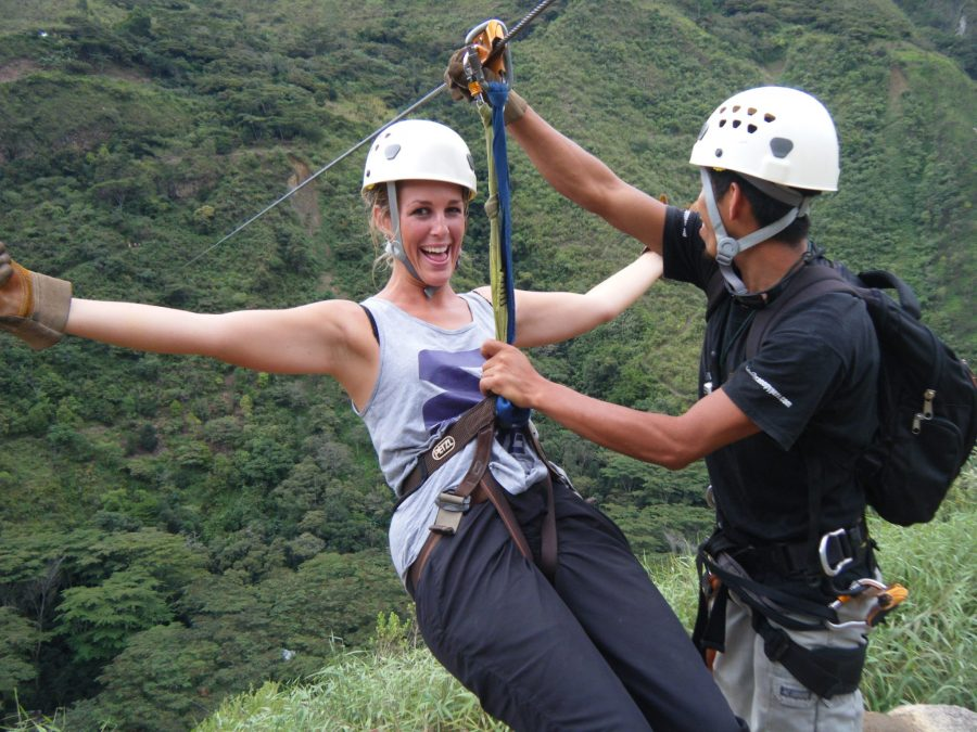 Inca Jungle Trail - Excited girl gets strapped into zipline.