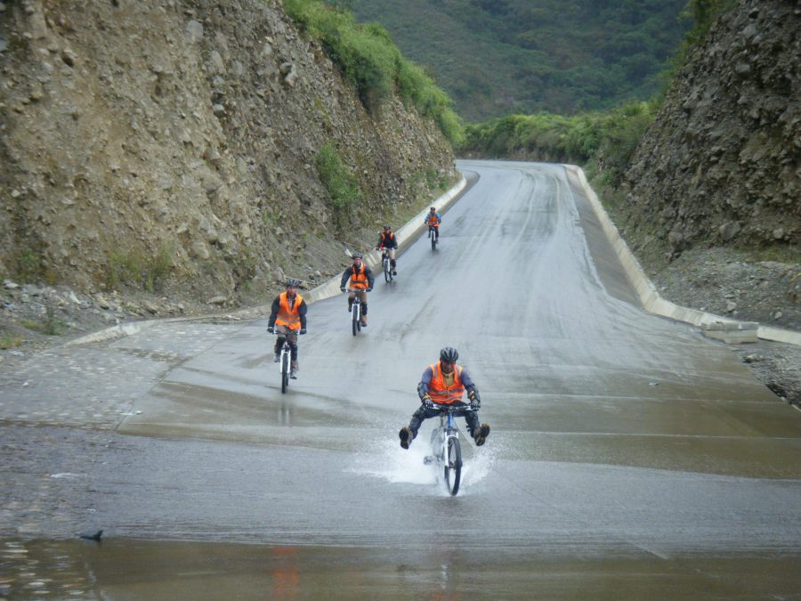 Inca Jungle Trail - Riding bikes through puddles.
