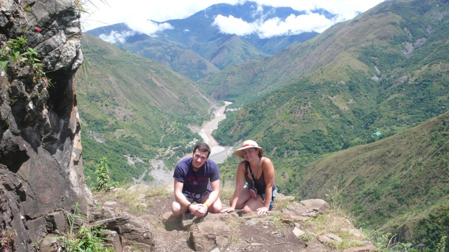 Inca Jungle Trail - Two hikers in front of a lovely valley viewpoint.