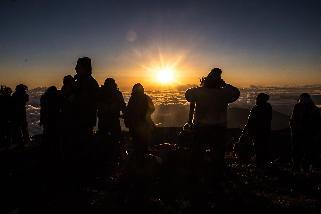 Crowds gather to watch the sunrise at Tres Cruces