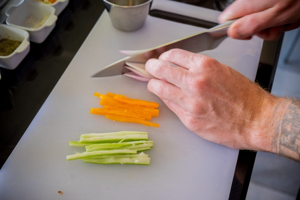 Cooking class in Cusco - Chopping vegetables for ceviche.