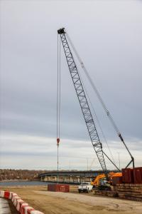 Crane lifting barge platforms into position
