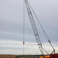Crane lifting barge platforms into position