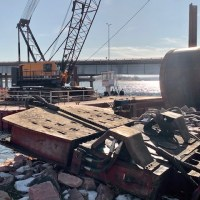 Giant vibratory hammer to drive sheet metal pilings into riverbed_3.12.21